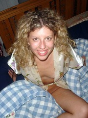 Curly wife shows her small breasts and..
