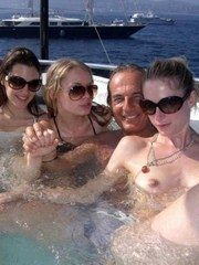 Girlfriends on vacation topless on a..